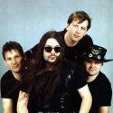Группа «Рок-Острова» в 1993—2002 гг. (слева направо): Анатолий Горбунов,  Владимир Захаров,  Олег Разин,  Александр Кутянов.
